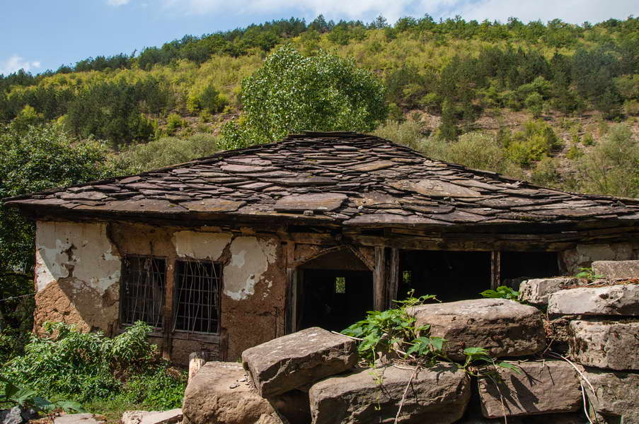 An old house with typical stone tiles on the roof